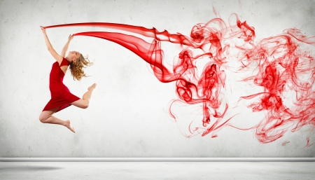 Portrait of a dancing young woman with red smoke curles photo