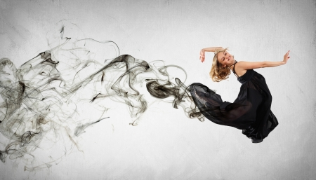 Beautiful young dancer with black smoke curles around her Stock Photo - 15539585