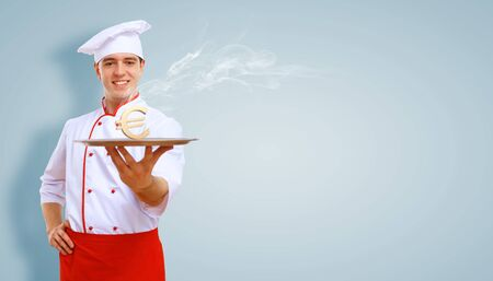Portrait of a young male cook in red apron against colour background Stock Photo - 15537234