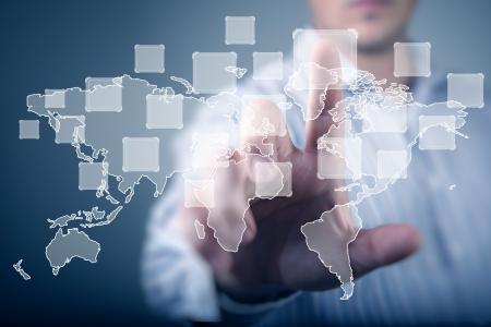 around the world: Modern Business World, A businessman navigating virtual world map