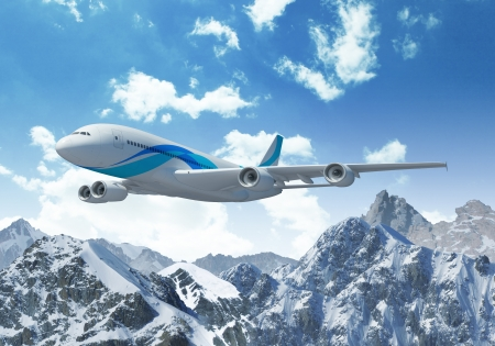 White passenger plane flying in the blue sky above the mountains with snow tops photo