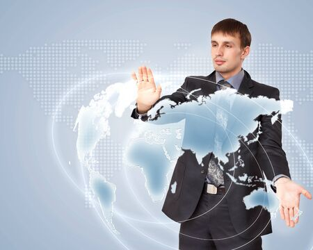 Modern Business World, A businessman navigating virtual world map Stock Photo - 15537268