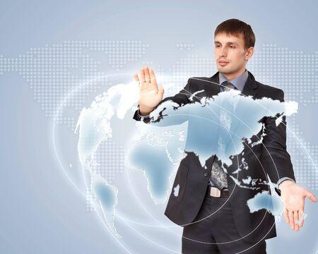 Modern Business World, A businessman navigating virtual world map Stock Photo - 15537268