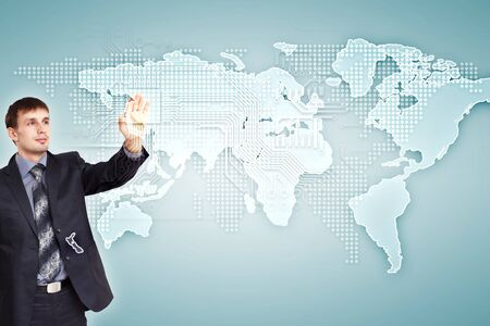 Modern Business World, A businessman navigating virtual world map Stock Photo - 15537264