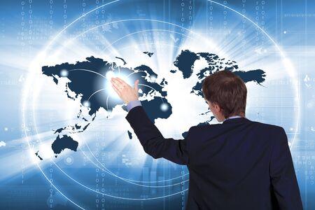 Modern Business World, A businessman navigating virtual world map Stock Photo - 15537271