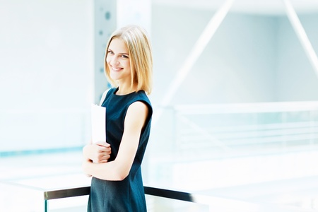 A portrait of a young business woman in an office Stock Photo - 15537396