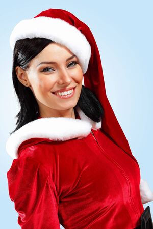 Santa Girl presenting your product, in costume and white gloves Stock Photo - 15536819