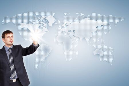 Modern Business World, A businessman navigating virtual world map Stock Photo - 15537169