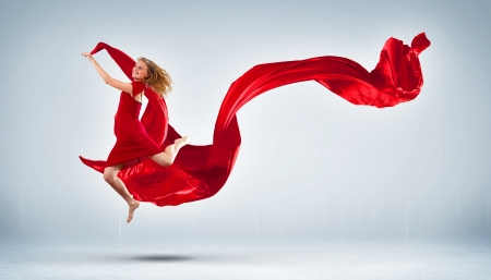 Portrait of a dancing young woman with red fabric Stock Photo - 15537154