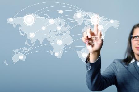 Modern Business World, A businessman navigating virtual world map Stock Photo - 15598040