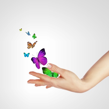 Human hands releasing colourful butterflies illustration on white background illustration