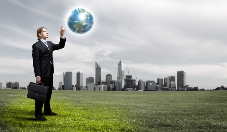 vision future: Businessman holding the world in the palm of his hand Elements of this image furnished by NASA  Stock Photo