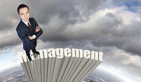 company vision: Businessman in suit standing on the word Management Stock Photo
