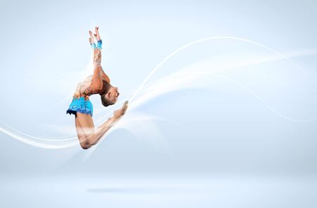 Young cute woman in gymnast suit show athletic skill on white background Stock Photo - 15600002