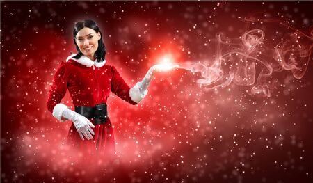 gloves women: Portrait of beautiful girl wearing santa claus clothes on red background Stock Photo