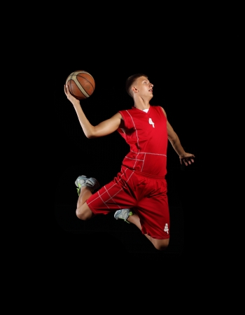 dunk: Male basketball player jumping and practicing with a ball
