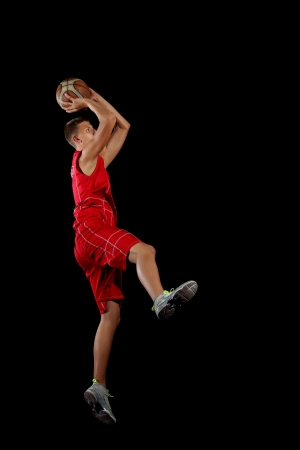 Male basketball player jumping and practicing with a ball Stock Photo - 15599985