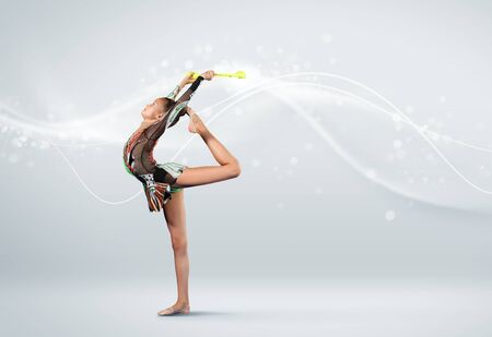 Young cute woman in gymnast suit show athletic skill on white background Stock Photo - 15647811