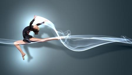 gymnastik: Ung söt kvinna i gymnast kostym visar atletisk färdighet på svart bakgrund Stockfoto