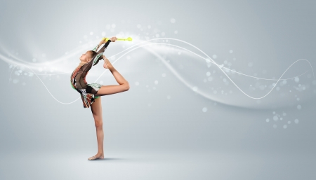 Young cute woman in gymnast suit show athletic skill on white background photo