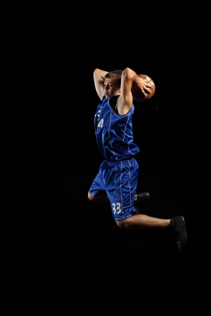 Male basketball player jumping and practicing with a ball Stock Photo - 15600014