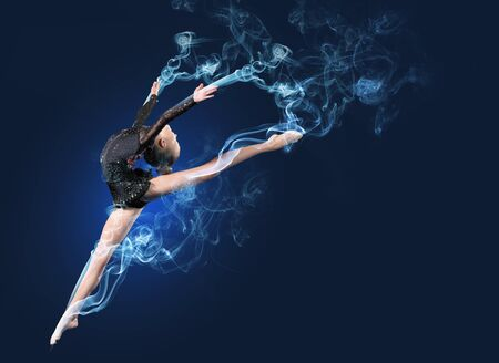 Young cute woman in gymnast suit show athletic skill on black background Stock Photo - 15691486