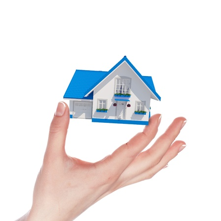 The house with colour roof in human hands Stock Photo - 15628204