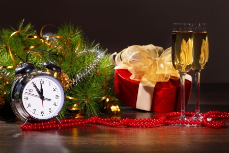 year s: New Year s still life with glasses of champagne  Decorations and ribbons on a bright color background