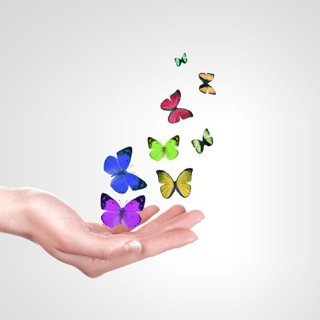 releasing: Human hands releasing a colourful butterflies illustration Stock Photo