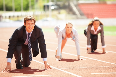 contestant: Businessmen running on track racing at athletich stadium Stock Photo