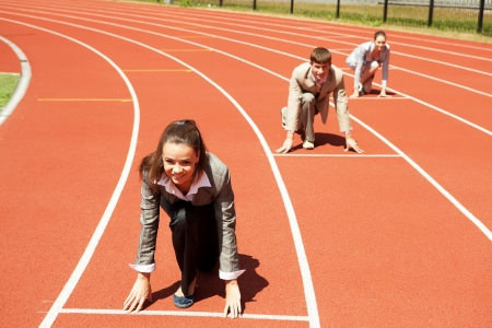 Businesswoman at athletic stadium and race track photo