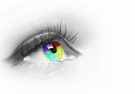 look at: Photo of the human eye against grey background Stock Photo