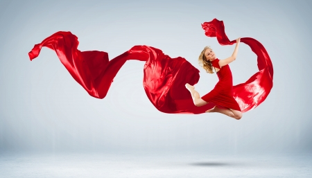 Portrait of a dancing young woman with red fabric Stock Photo - 15675689