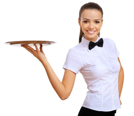 business dinner: Portrait of young waitress with an empty tray