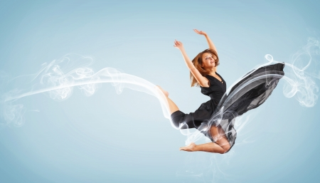 Portrait of a dancing young woman with smoke curles around Stock Photo - 15661684