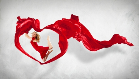 Portrait of a dancing young woman with red fabric Stock Photo - 15661698