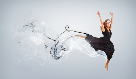 Beautiful young dancer with black smoke curles around her Stock Photo - 15675688