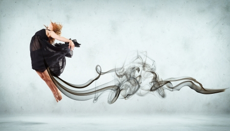 Beautiful young dancer with black smoke curles around her Stock Photo - 15661697