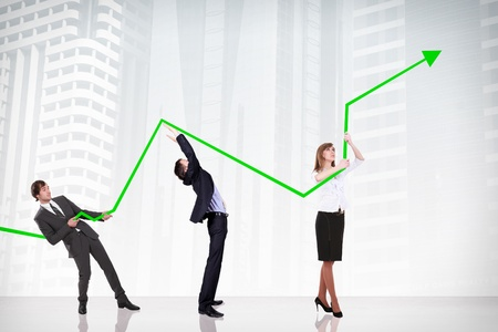 business people pushing a business graph upwards photo