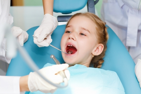 hygienist: Little girl sitting in the dentists office