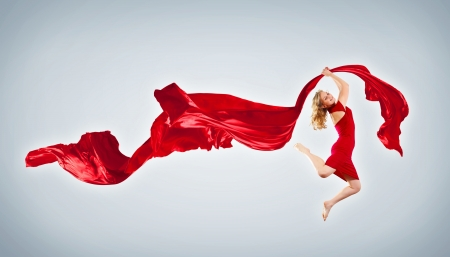 Portrait of a dancing young woman with red fabric Stock Photo - 15661683