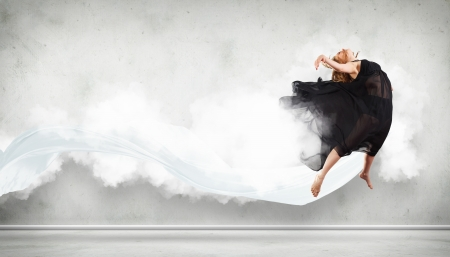 Portrait of a dancing young woman with white cloudy smoke around Stock Photo - 15628942