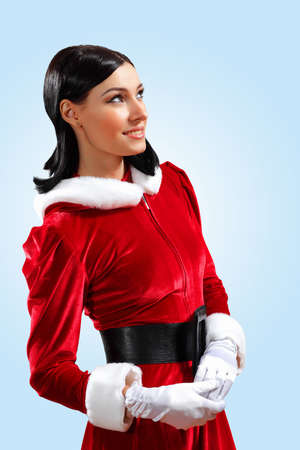 Santa Girl presenting your product, in costume and white gloves Stock Photo - 15628935