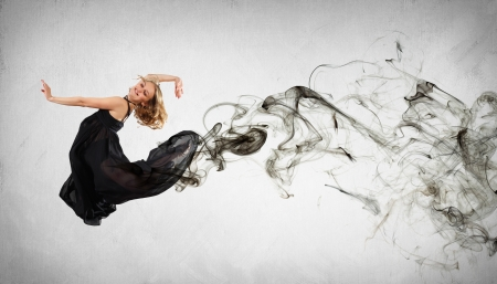 Beautiful young dancer with black smoke curles around her Stock Photo - 15661630