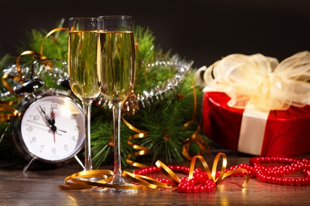 cristmas: New Year s still life with glasses of champagne  Decorations and ribbons on a bright color background
