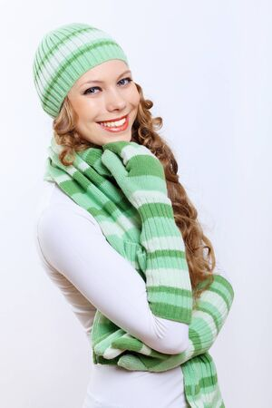 Young pretty woman in warm winter hat and scarf photo