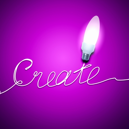 Abstract Light Bulb with the word Create on pink background  photo