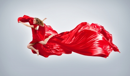 Portrait of a dancing young woman with red fabric Stock Photo - 15684016