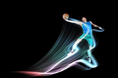 practise: Male basketball player jumping and practicing with a ball