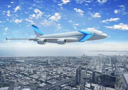 White passenger plane flying in the day blue sky above a city